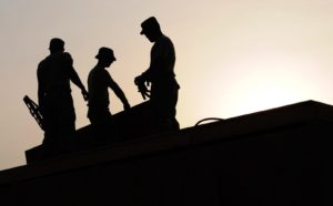 silhouette-of-workers-on-construction-site